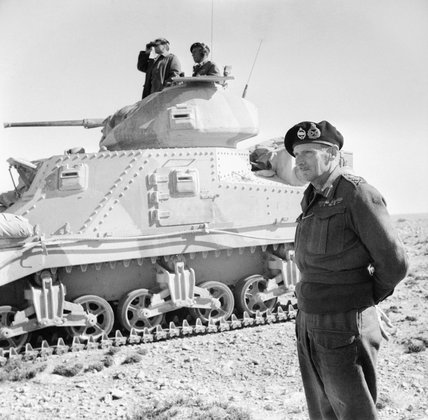 General Montgomery stands beside a Grant command tank near Tripoli, 27 January 1943.