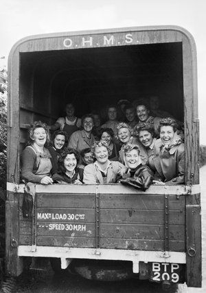 A group of happy Land Army girls in the back of a truck in Devon, England during the Second World War.