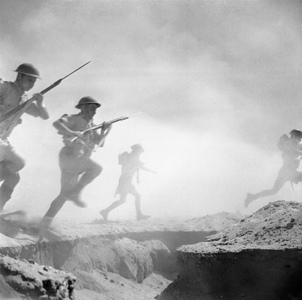 Posed 'action' photograph of British troops at El Alamein in North Africa, 24 October 1942.