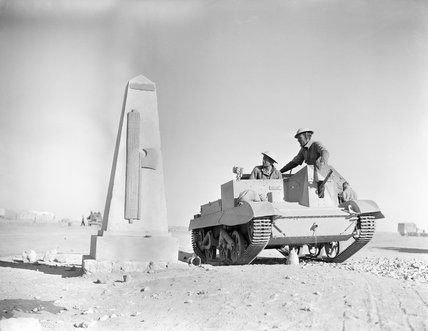 The crew of a Bren gun carrier pause to look at a monument erected by the Italians to commemorate the capture of Sidi Barrani in Egypt a few months earlier, 16 December 1940.