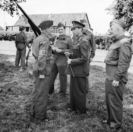 King George VI talking to a member of the Home Guard during an inspection in Kent, 10 August 1940.