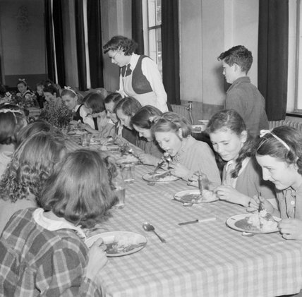 Children having lunch at Baldock County Council School in Hertfordshire during 1944.