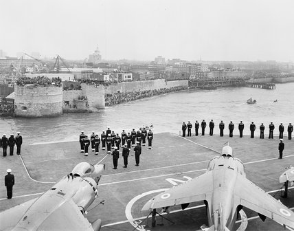 The aircraft carrier HMS HERMES sails out of Portsmouth for the South Atlantic, at the start of the Falklands War, 1982.