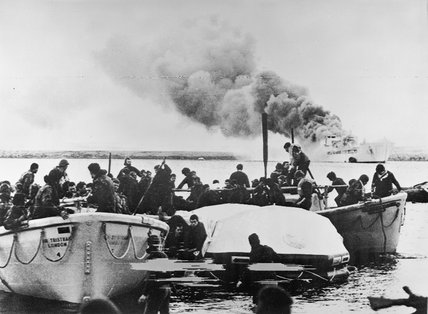 Lifeboats carrying soldiers of 1st Battalion Welsh Guards from the blazing RFA SIR GALAHAD after the devastating Argentine air attack at Fitzroy in the Falkland Islands, 8 June 1982.
