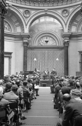 War workers listening to a lunchtime concert by the Blech String Quartet in the central hall of the National Gallery in Trafalgar Square, London, 1943.