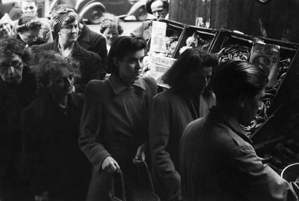 Women queue for potatoes at a greengrocer's shop in London during 1945.