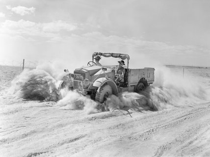 A British Army 15-cwt truck throws up a cloud of sand and dust while moving at speed along a desert track in North Africa, 1 November 1940.