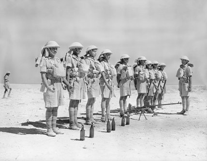 Indian troops in North Africa parade with a Boys anti-tank rifle and 'Molotov cocktail' petrol bombs, 6 October 1940.