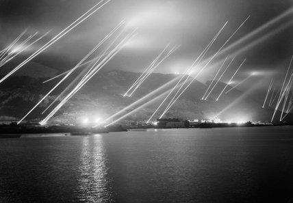 Searchlights pierce the night sky during an air-raid practice on Gibraltar, 20 November 1942.