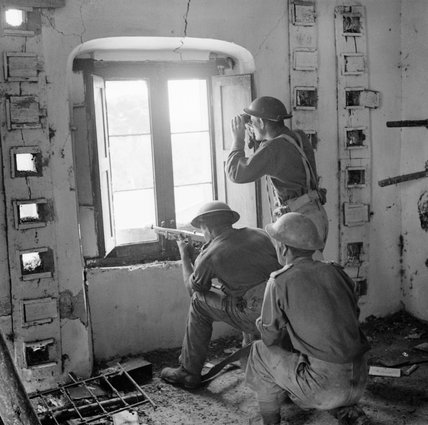 Men of the 9th Battalion, Royal Fusiliers at an observation post in a ruined house at Salerno, September 1943.