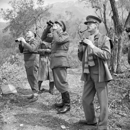 General Oliver Leese, commanding British Eighth Army in Italy, with his corps commanders watching an Allied bombing raid on Cassino, 15 March 1944.