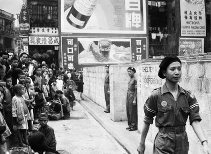 Air raid wardens take up position at the entrances to public shelters in Hong Kong, during an exercise in the last days before the Japanese invasion, December 1941.