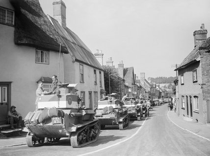 Vickers Mk VI light tanks pass through the village of Linton in Cambridgeshire, 30 August 1940.