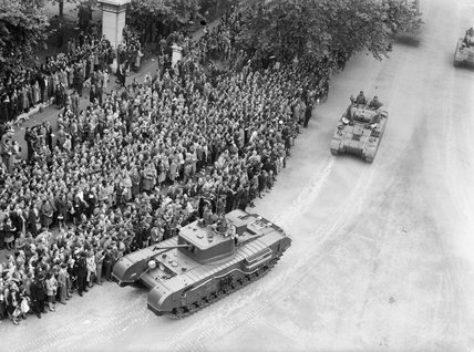 A Churchill Mk VII tank leads a group of Shermans as part of the Royal Tank Regiment's contingent during the London Victory Parade, 8 June 1946.