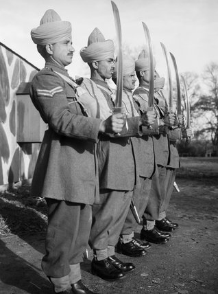 Mule handlers of the Royal Indian Army Service Corps parade with drawn swords, 16 November 1940.