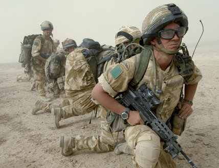 Soldiers of 3rd Parachute Regiment and 'D' Squadron, Household Cavalry, wait to board a Chinook helicopter during operations to secure the town of Nowzad in Helmand, Afghanistan, 31 July 2006.