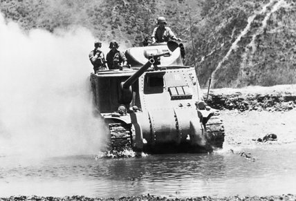 A British Lee tank crosses a river north of Imphal to meet the Japanese advance in Burma, 1944.