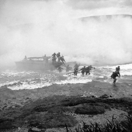 Troops coming ashore from a landing craft under a smoke screen during Combined Operations training at Inveraray, Scotland, 9 October 1941.