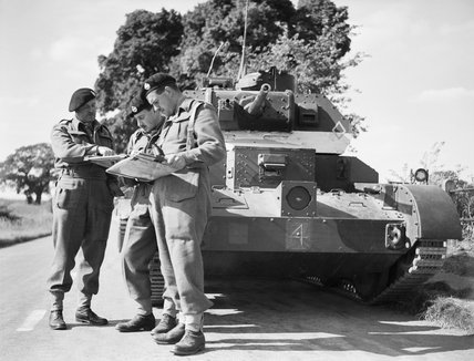 Royal Tank Regiment officers confer in front of a Cruiser Mk IVA tank during exercises in East Anglia, 30 August 1940.