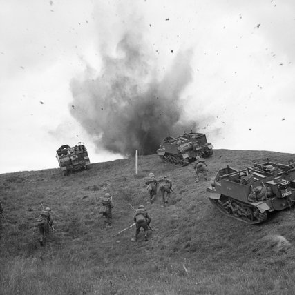 Universal carriers and infantry of 10th Battalion, Royal Berkshire Regiment advance 'under fire' during training near Sudbury in Suffolk, 10 June 1942.