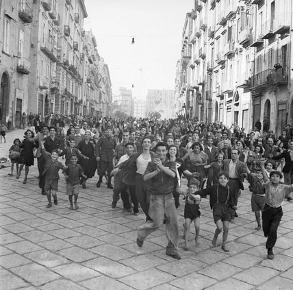 Cheering crowds great Allied troops as they enter Naples, 1 October 1943.