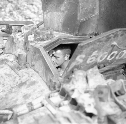 The driver of a Bishop 25-pdr self-propelled gun of 142nd Field Regiment in Sicily, 27 July 1943.