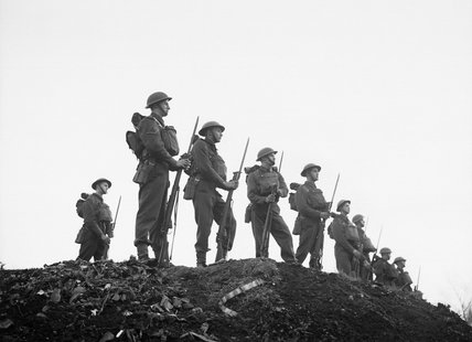 Soldiers of the East Surrey Regiment pose with fixed bayonets at Chatham in Kent, 25 November 1940.