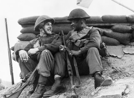 Men of the 1st Battalion, The Black Watch rest before moving off on a patrol in Korea, 1952.