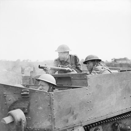 A Universal Carrier crew of the 2nd Sherwood Foresters fire a 2-inch mortar from their vehicle in the Anzio bridgehead, Italy,  April 1944.