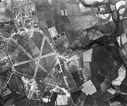 Aerial view of the RAF Coastal Command airfield at St Eval in Cornwall, 18 July 1942. Bomb craters left by previous Luftwaffe raids can be seen.