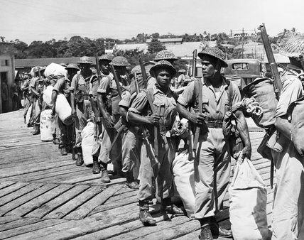 Troops of the Fiji Infantry Regiment preparing for embarkation for overseas service against the Japanese, 1944.