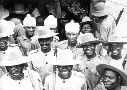Indian soldiers mingle with men of the 81st West African Division after the latter had arrived in India for jungle training. The first African colonial troops to fight outside Africa, the 81st Division went on to Burma in December 1943.