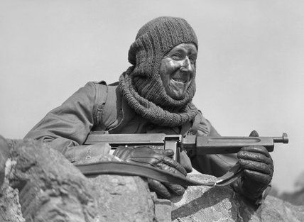 Portrait of a soldier from No. 3 Commando armed with a 'Tommy gun' and wearing a balaclava, at Largs in Scotland, 2 May 1942.