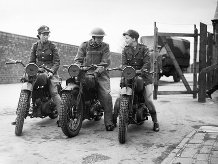 Two ATS (Auxiliary Territorial Service) trainee motorcycle despatch riders and a Royal Army Service Corps instructor at York, 23 May 1941.