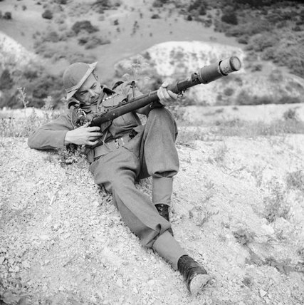 A member of the Home Guard demonstrates a rifle equipped to fire an anti-tank grenade, Dorking, 3 August 1942.