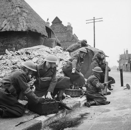 A squad of Home Guard soldiers training to defend a street with 'Molotov cocktail' petrol bombs, March 1941.
