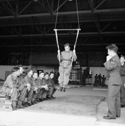 Paratroopers learn to land correctly using a special harness at RAF Ringway, August 1942.