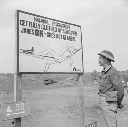 A malaria warning sign on the Anzio front in Italy, advising troops to cover up in the evening to avoid mosquito bites, 10 May 1944.