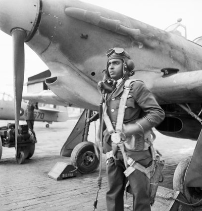 A student pilot of the Indian Air Force beside his Hawker Hurricane at a Flying Training School at Kohat, on the North West Frontier of India, 1943.