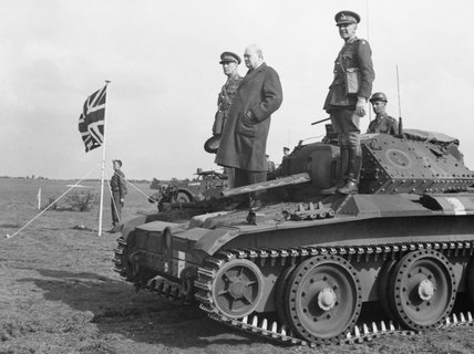 Winston Churchill stands on a Covenanter tank of 4th/7th Royal Dragoon Guards, to take the salute at an  inspection of 9th Armoured Division near Newmarket, Suffolk, 16 May 1942.