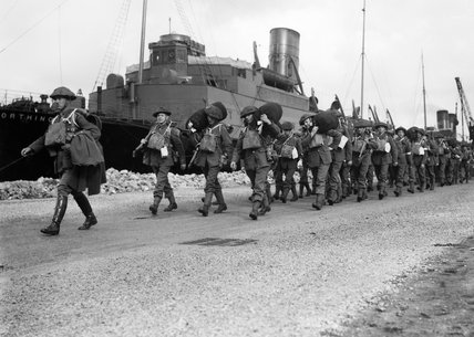 Troops of 'B' Battery, 9th Field Brigade, Royal Artillery, marching from the quayside having disembarked from the troopship 'Worthing' at Cherbourg in France, 16 September 1939.