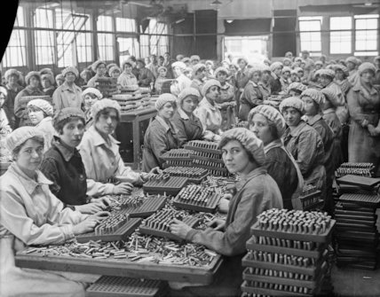 Women munition workers finish small arms cartridges in Small Arms Cartridge Factory No.3 at Woolwich Arsenal.