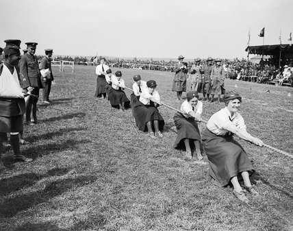 Women ambulance drivers compete in a tug-of-war event at a Royal Air Force sports event at Rang du Fliers on 25 August 1918.