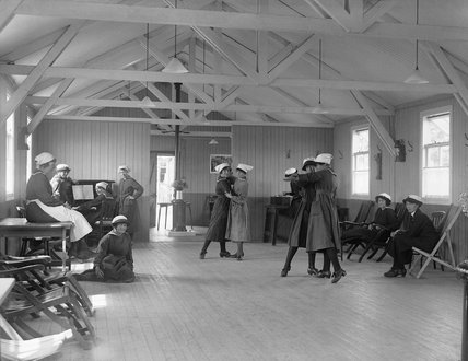 Women of the Women's Royal Naval Service (WRNS) enjoy a dance in their recreation room on Osea Island in Essex during the summer of 1918.