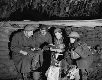 The cramped interior of the battery commander's dugout at a 25-pdr field gun battery near Mouchin, France, 29 November 1939.