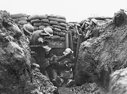 Men of the Lancashire Fusiliers cleaning a Lewis gun in a trench near Messines in Belgium during January 1917.
