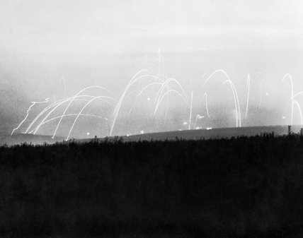 The dawn sky is lit by the bombardment before the assault on Thiepval, 15 September 1916, during the Battle of the Somme.