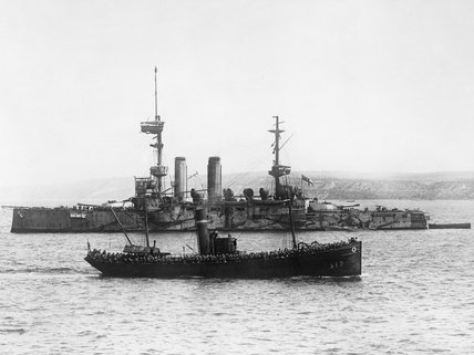 British troops passing the battleship HMS IMPLACABLE on their way to land on the Gallipoli Peninsula in 1915.