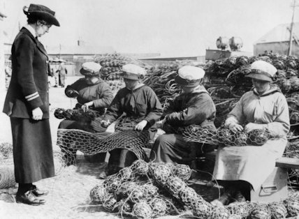 Ratings of the WRNS wire together glass floats as part of their work as mine net workers.