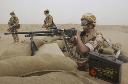 Men of No. 653 Squadron, Army Air Corps, manning a General Purpose Machine Gun position at the entrance to the British Army base in Kuwait, 20 February 2003.